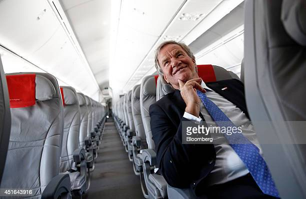 Bjoern Kjos chief executive officer of Norwegian Air Shuttle AS poses for a photograph on board a Boeing Co 787 Dreamliner ahead of the company's...