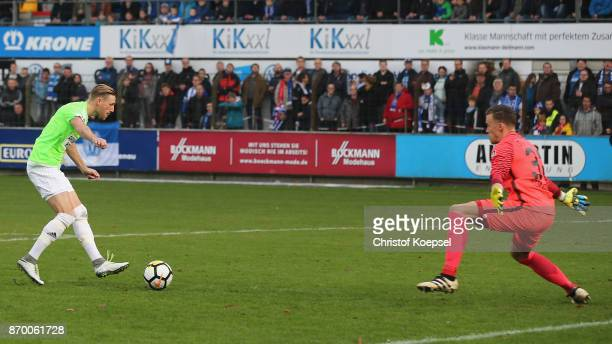 Bjoern Kluft of Chmenitz scores the first goal against Eric Domaschke of Meppen during the 3 Liga match between SV Meppen and Chemnitzer FC at...