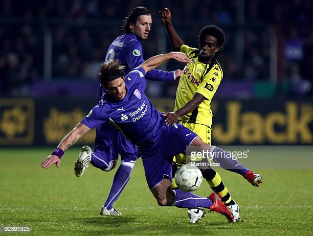 Bjoern Lindemann of Osnabruck and Tinga of Dortmund battle for the ball during the DFB Cup third round match between VfL Osnabrueck and Borussia...