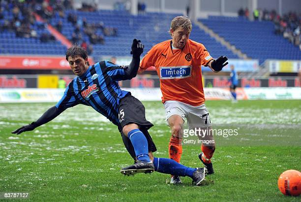 Bjoern Lindemann of Paderborn and Andreas Mayer of Aalen during the 3 Bundesliga match between SC Paderborn and VfR Aalen at the Paragon Arena on...