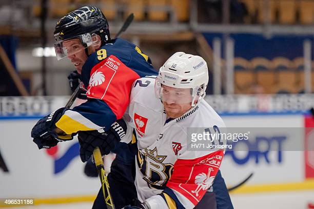 Bjoern Melin of HV71 in struggle with Jari Sailo of Espoo Blues during the Champions Hockey League round of eight game between HV71 Jonkoping and...