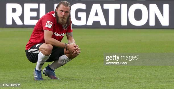 Bjoern Paulsen of FC Ingolstadt reacts after his team's 2-3 loss of the Second Bundesliga playoff second leg match between Wehen Wiesbaden and FC...