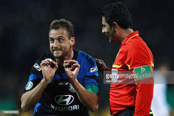 Bjoern Schlicke of Frankfurt argues with referee Babak Rafati during the DFB Cup second round match between FSV Frankfurt and FC Schalke 04 at the...