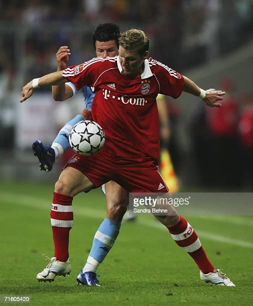 Bjoern Ziegenbein of 1860 and Bastian Schweinsteiger of Bayern battle for the ball during the Giovane Elber farewell match between Bayern Munich and...