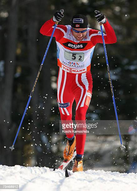 BjoernOdd Hjelmeset of Norway leads a pack of competitors in the Men's Cross Country 4 x 10 km Relay Classical and Free Event during the FIS Nordic...