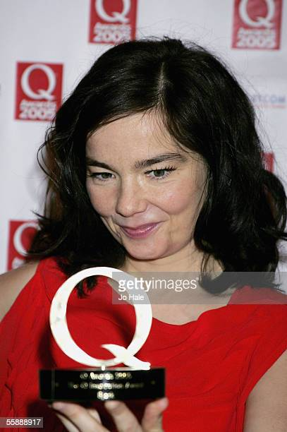 Bjork poses in the awards room with the Q Inspiration Award at The Q Awards, the annual magazine's music awards, at Grosvenor House on October 10,...