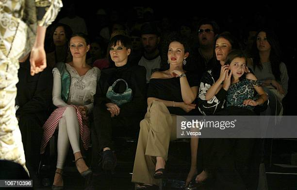 Bjork Shannon Factor wearing Alvin Valley pants and Judith Ripka jewelry and Mimi Rogers with her daughter