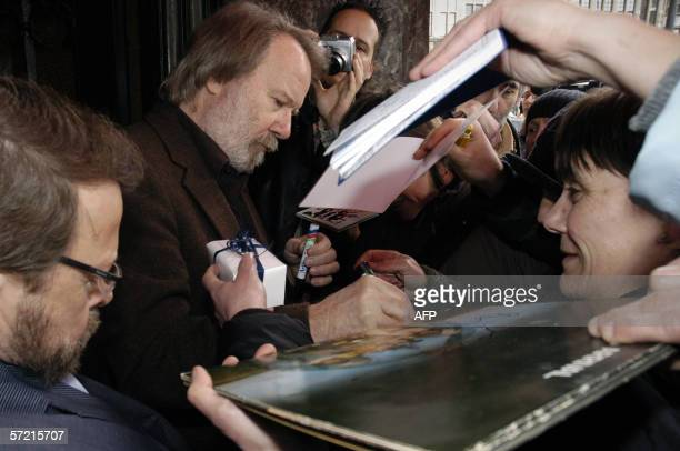 Bjorn and Benny of legendary Swedish pop band ABBA sign autogrphs for fans as he arrives in Antwerp 30 March 2006 to attend a performance of the...