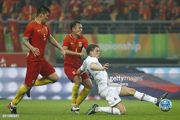 Bjorn Bergmann Sigurdarson of Iceland competes the ball with Fan Xiaodong and Yang Shanping of China during the 2017 Gree China Cup International...
