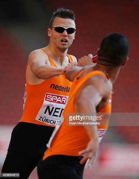Bjorn Blauwhof of the Netherlands hands over to Terrence Agard in a rerun of the Mens 4x400m heat during the 22nd European Athletic Championships at...