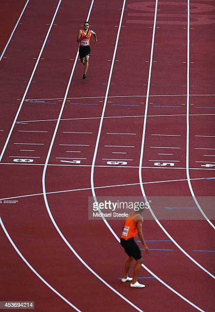 Bjorn Blauwhof of the Netherlands prepares to hand over to Terrence Agard in a rerun of the Mens 4x400m heat during the 22nd European Athletic...