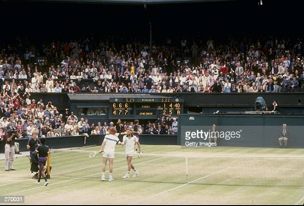 Bjorn Borg and John McEnroe shake hands after a match at Wimbledon in England.
