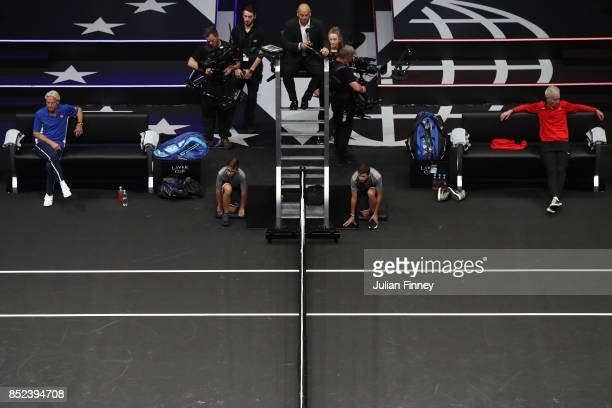 Bjorn Borg Captain of Team Europe and John Mcenroe Captain of Team World watch as Nick Kyrgios of Team World plays his singles match against Tomas...