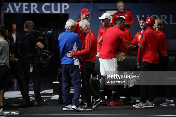 Bjorn Borg Captain of Team Europe and John Mcenroe Captain of Team World embrace after Roger Federer and Rafael Nadal of Team Europe win there...