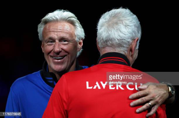Bjorn Borg, Captain of Team Europe embraces John McEnroe, Captain of Team World prior to the start of the singles match between Milos Raonic of Team...