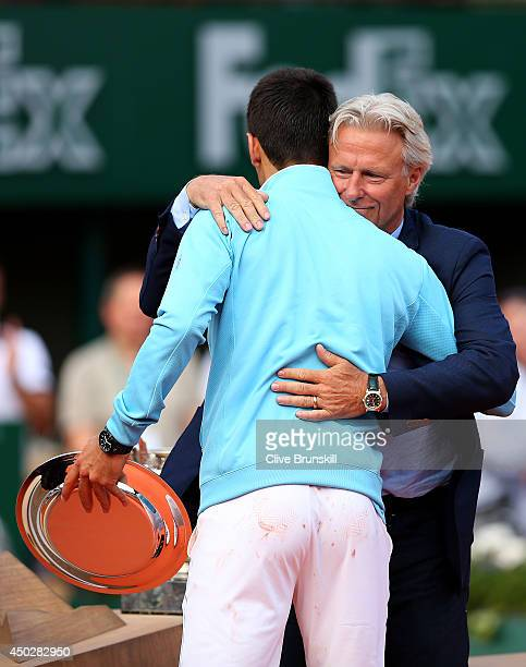 Bjorn Borg consoles Novak Djokovic of Serbia after his defeat in the men's singles final match against Rafael Nadal of Spain on day fifteen of the...