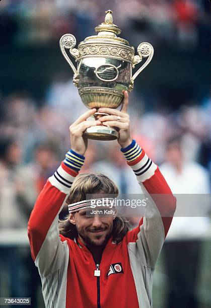 Bjorn Borg hoists his trophy for his fifth Wimbledon title in a row defeating John McEnroe in the 1980 men's singles final