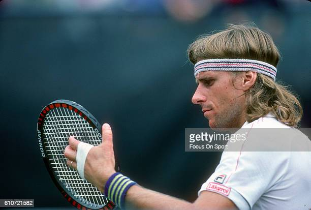 Bjorn Borg of Sweden checks the strings in his racket during a match at the Men's 1981 US Open Tennis Championships circa 1981 at the National Tennis...