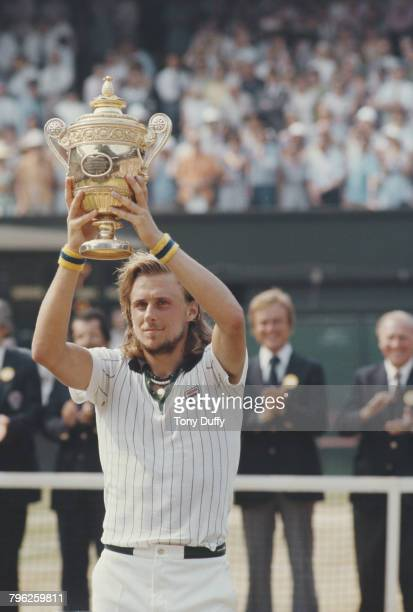 Bjorn Borg of Sweden holds the Gentleman's trophy aloft after defeating Ilie Nastase of Romania during the Men's Singles Final match at the Wimbledon...
