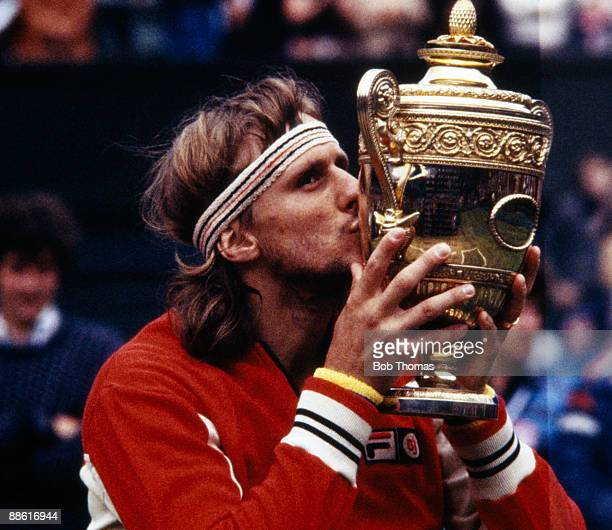 Bjorn Borg of Sweden kissing the trophy after winning the men's singles final at the Wimbledon Lawn Tennis Championships held at the All England Club...