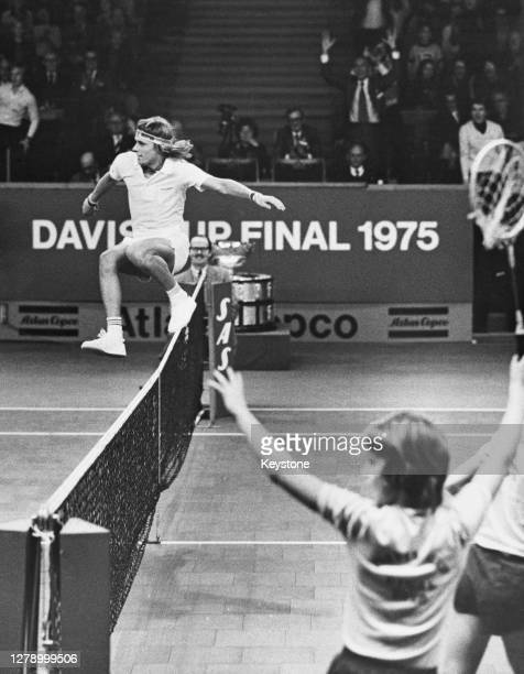 Bjorn Borg of Sweden leaps over the net to celebrate defeating Jan Kodes of Czechoslavakia during their Men's Singles match to win the 64th edition...