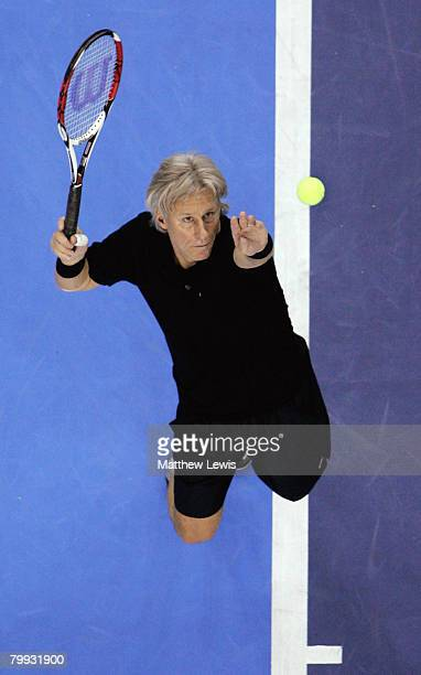 Bjorn Borg of Sweden serves against John McEnroe of the United States during the second day of the BlackRock Tour of Champions at the Odyssey Arena...