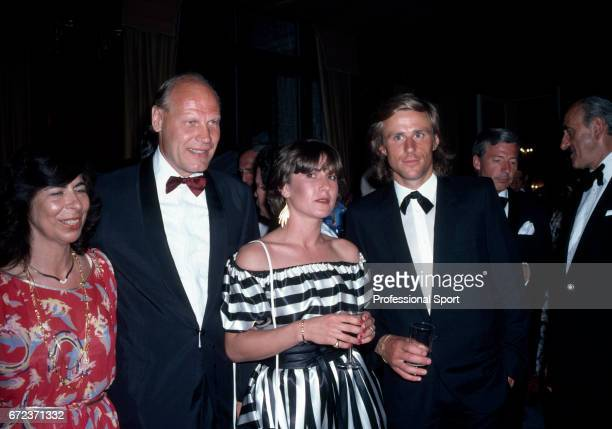 Bjorn Borg of Sweden with his fiance Marianna Simionescu and coach Lennart Bergelin at the Wimbledon Champions Ball after Borg won the men's singles...