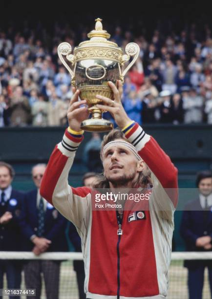 Bjorn Borg of the Sweden holds the Gentlemen's Singles Championship Trophy aloft after defeating Jimmy Connors of the United States during the Men's...