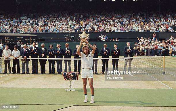 Bjorn Borg of the Sweden holds the trophy aloft after defeating Ilie Nastase of Romania during the Men's Singles Final match at the Wimbledon Lawn...
