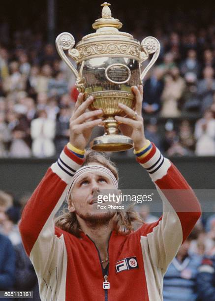 Bjorn Borg of the Sweden holds the trophy aloft after defeating Jimmy Connors of the United States during the Men's Singles Final match at the...
