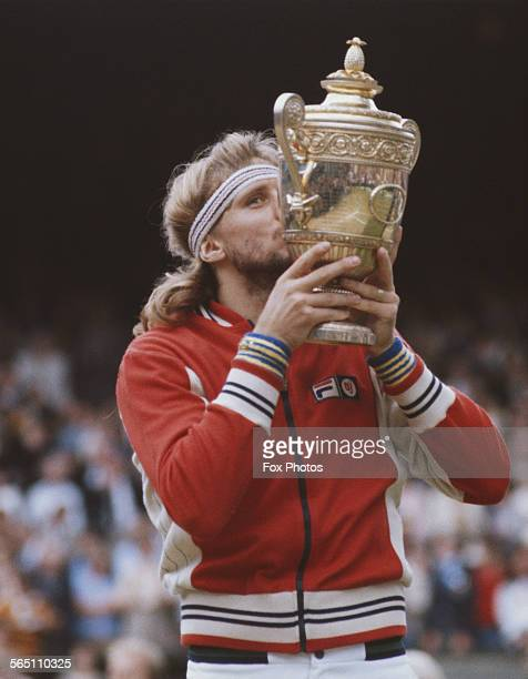 Bjorn Borg of the Sweden kissing the trophy after defeating John McEnroe of the United States during the Men's Singles Final match at the Wimbledon...