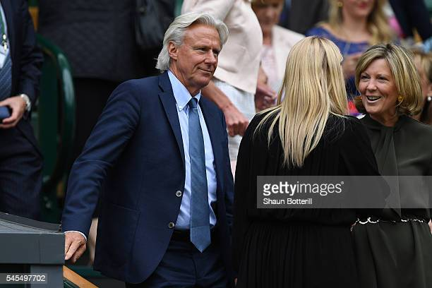 Bjorn Borg watches on as Roger Federer of Switzerland plays Milos Raonic of Canada in the Men's Singles Semi Final match on day eleven of the...