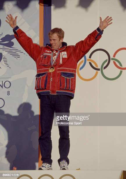 Bjorn Dahlie of Norway celebrates after winning gold in the Men's 50km Freestyle CrossCountry Skiing event at the Winter Olympic Games in Nagano...