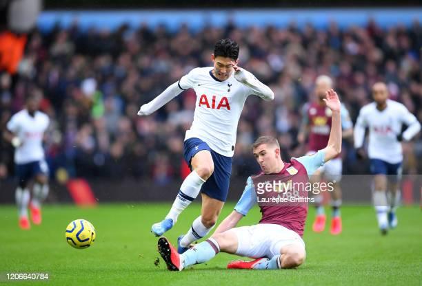 Bjorn Engels of Aston Villa tackles Heung-Min Son of Tottenham Hotspur during the Premier League match between Aston Villa and Tottenham Hotspur at...