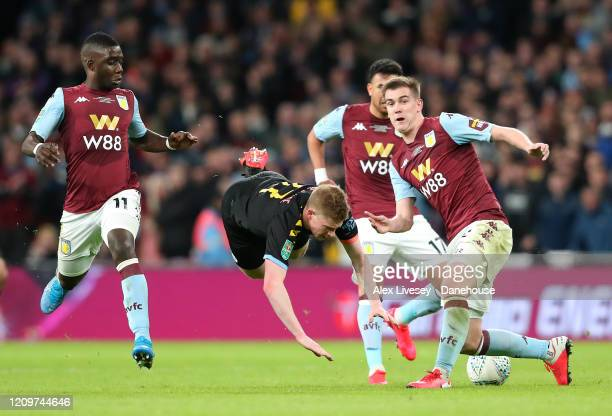 Bjorn Engels of Aston Villa tackles Kevin De Bruyne of Manchester City during the Carabao Cup Final between Aston Villa and Manchester City at...