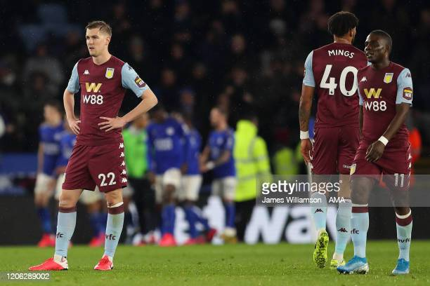 Bjorn Engels, Tyrone Mings and Marvelous Nakamba of Aston Villa dejected after Harvey Barnes of Leicester City scored a goal to make it 1-0 during...