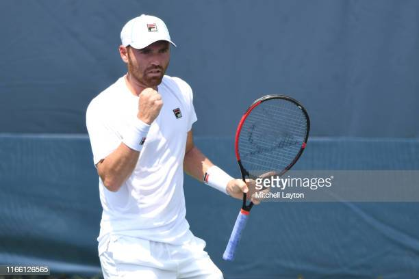 Bjorn Fratangelo of the United States celebrates winning a shot from Ivo Karlovic of Croatia during Day 1 of the Citi Open at Rock Creek Tennis...