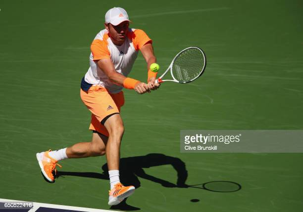 Bjorn Fratangelo of the United States plays a backhand against Bernard Tomic of Australia in their first round match during day four of the BNP...