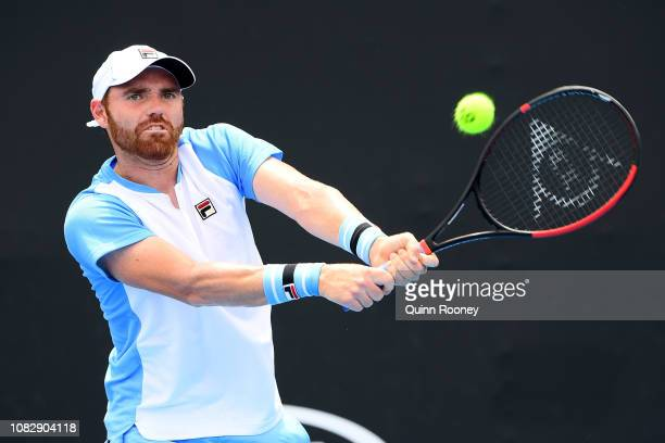 Bjorn Fratangelo of the United States plays a backhand in his first round match against Gilles Simon of France during day two of the 2019 Australian...