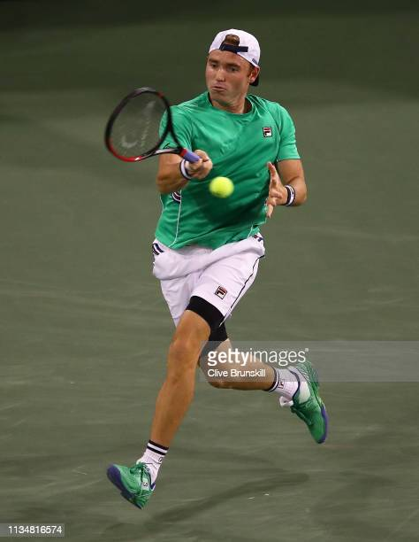 Bjorn Fratangelo of the United States plays a forehand against Novak Djokovic of Serbia during their men's singles second round match on day six of...