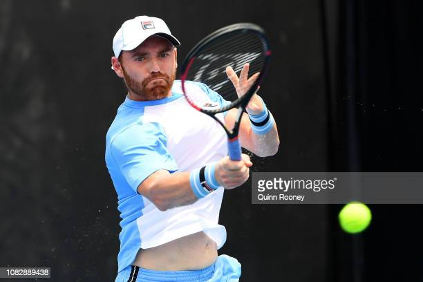 Bjorn Fratangelo of the United States plays a forehand in his first round match against Gilles Simon of France during day two of the 2019 Australian...