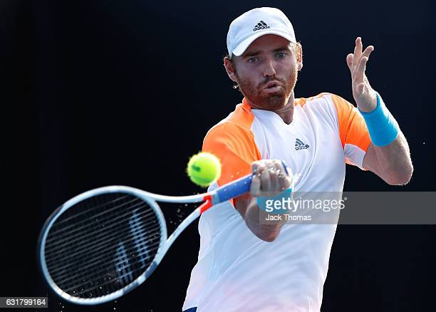 Bjorn Fratangelo of the United States plays a forehand in his first round match against Noah Rubin of the United States on day one of the 2017...