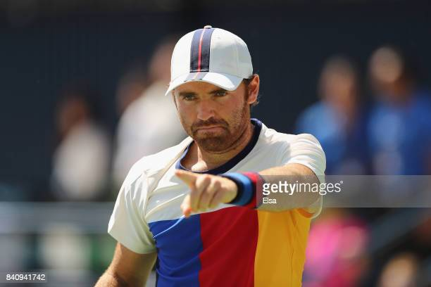 Bjorn Fratangelo of the United States reacts against Ivo Karlovic of Croatia during their first round Men's Singles match on Day Three of the 2017 US...