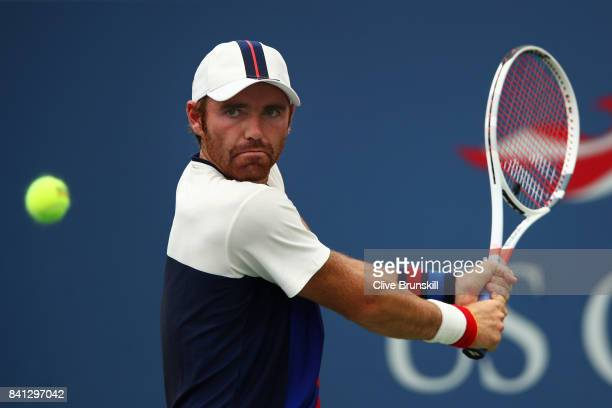 Bjorn Fratangelo of the United States returns a shot against Adrian Mannarino of France during their second round Men's Singles match on Day Four of...