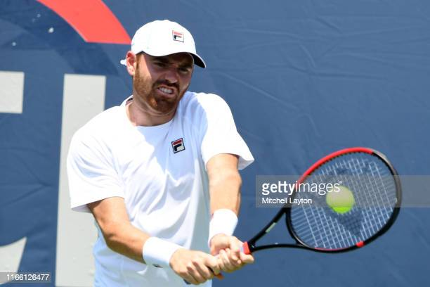 Bjorn Fratangelo of the United States returns a shot form Ivo Karlovic of Croatia during Day 1 of the Citi Open at Rock Creek Tennis Center on July...