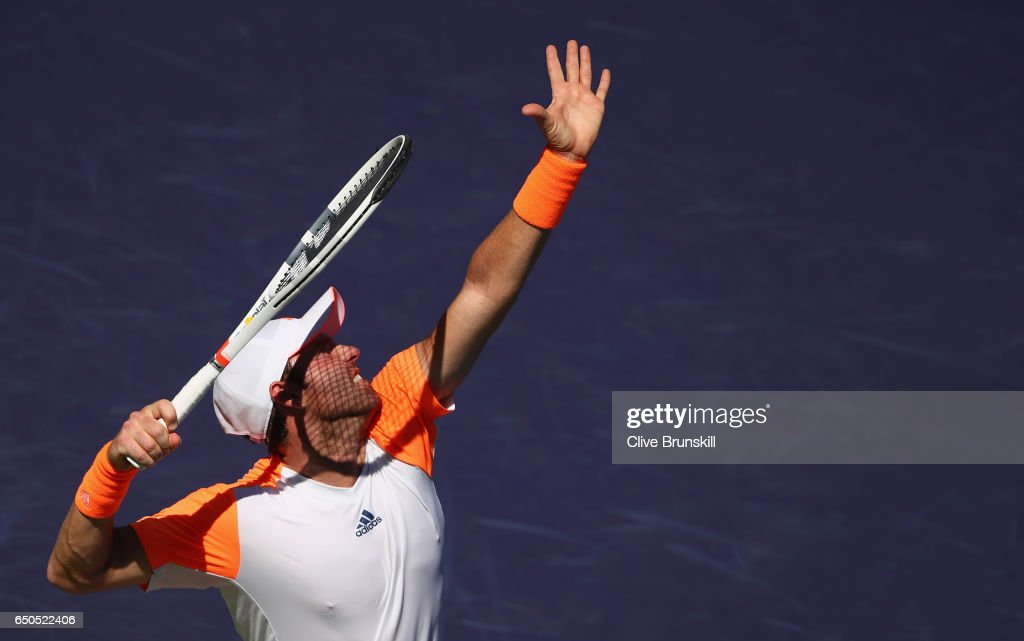 Bjorn Fratangelo of the United States serves against Bernard Tomic of Australia in their first round match during day four of the BNP Paribas Open at Indian Wells Tennis Garden on March 9, 2017 in Indian Wells, California.