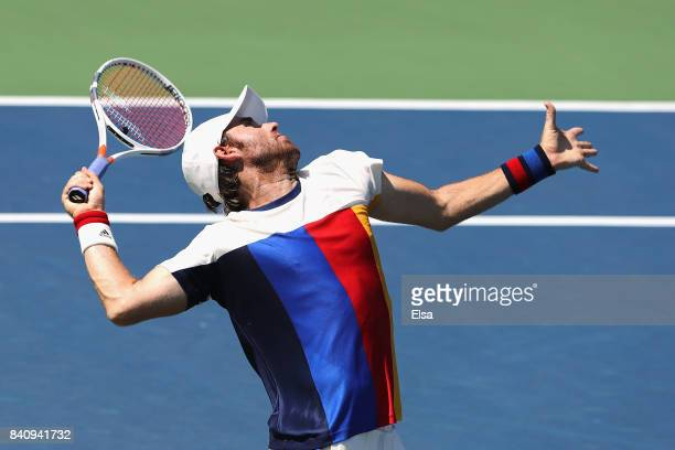 Bjorn Fratangelo of the United States serves to Ivo Karlovic of Croatia during their first round Men's Singles match on Day Three of the 2017 US Open...