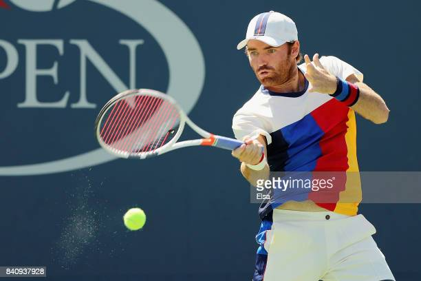 Bjorn Fratangelo of the United Statesreturns a shot to Ivo Karlovic of Croatia during their first round Men's Singles match on Day Three of the 2017...