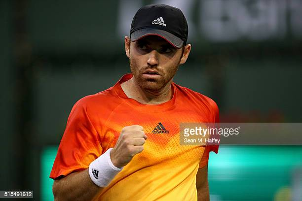 Bjorn Fratangelo reacts to a shot against Novak Djokovic of Serbia during the BNP Paribas Open at the Indian Wells Tennis Garden on March 11 at...