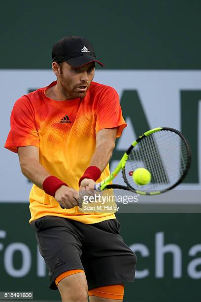 Bjorn Fratangelo returns a shot against Novak Djokovic of Serbia during the BNP Paribas Open at the Indian Wells Tennis Garden on March 11 at Indian...